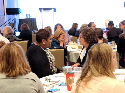 Attendees participate in group activities during a session on reducing burnout.