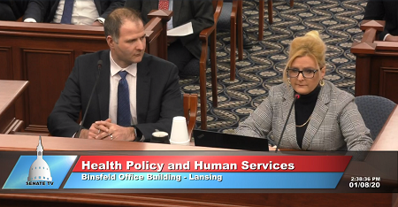 Gabe Schneider (left), director, government relations, and Cheryl Wieber, MHA (right), executive director, heart and vascular service line, Munson Healthcare, testify in opposition to Senate Bill 675.