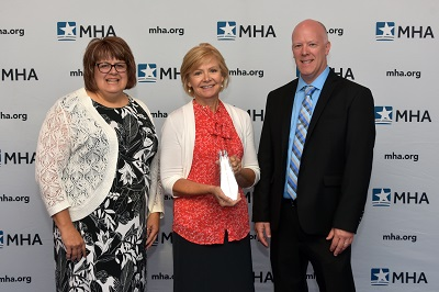 Beth Langenburg, director of Community Health; Mary Kay VanDriel, president; and Scott Lombard, manager of community education, Spectrum Health Big Rapids and Reed City Hospitals.