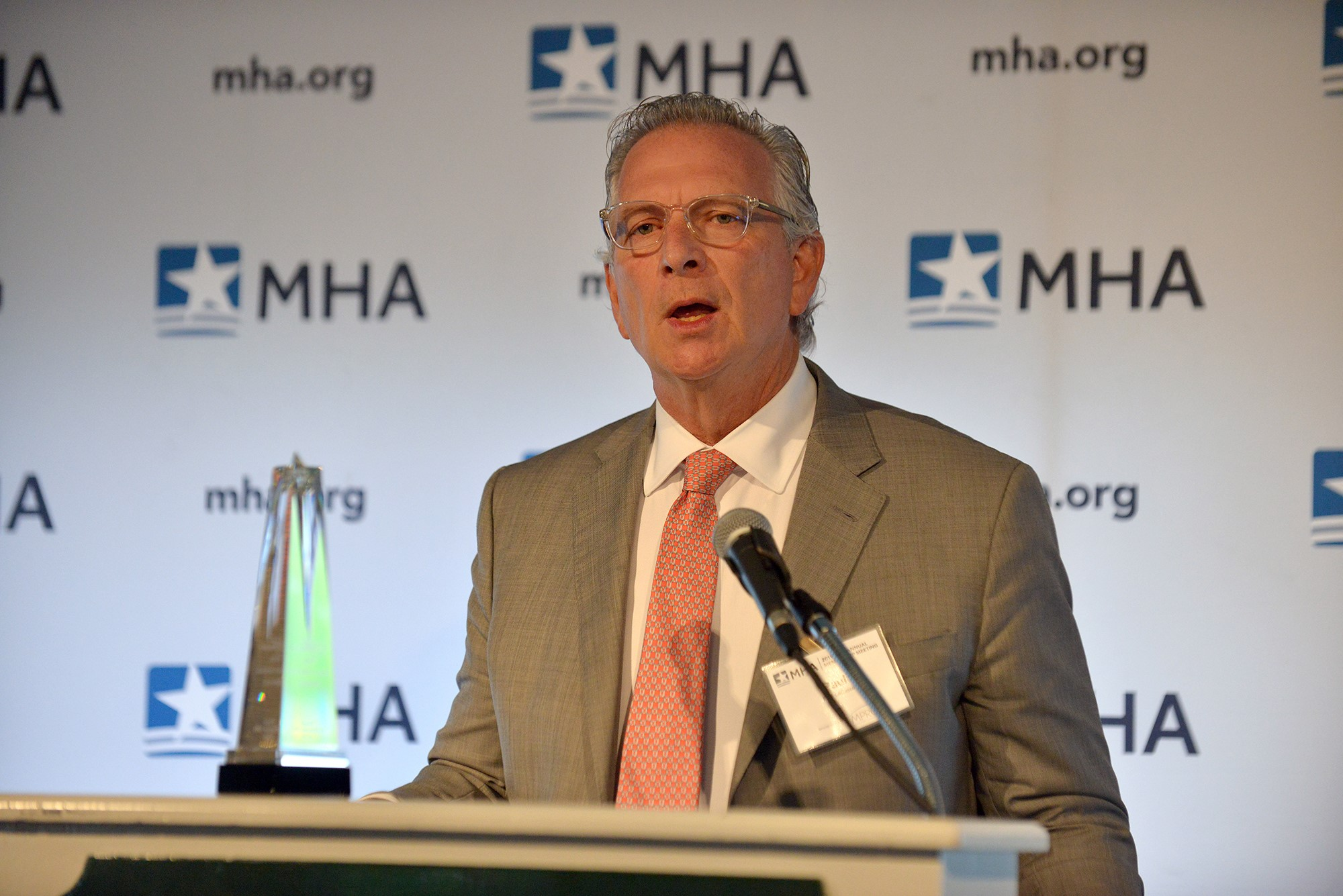 Paul E. LaCasse, DO, MPH, receiving the MHA Meritorious Service Award.